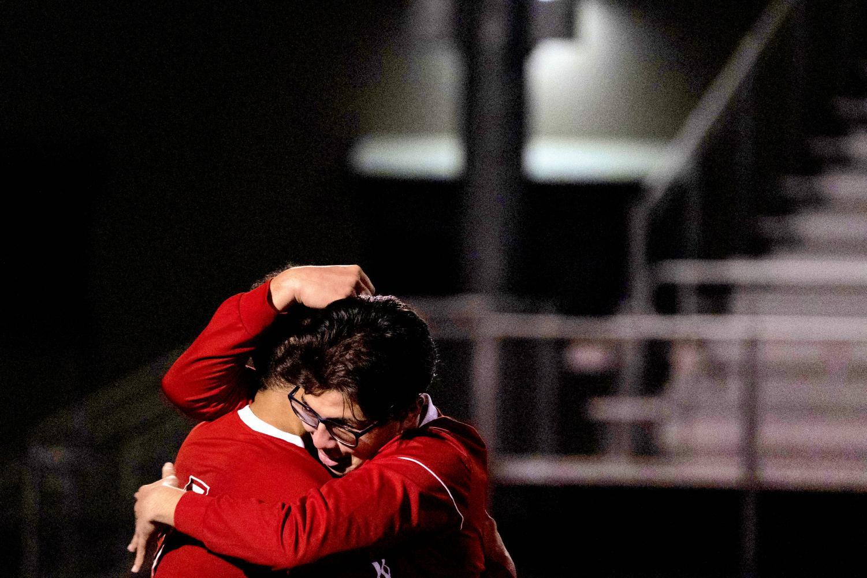 Martin Sanchez hugging Javier Cornejo after victory against Mount Eden.